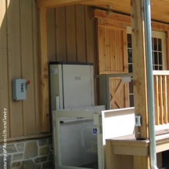 Savaria Multilift Vertical Platform Lift attached to an outdoor deck