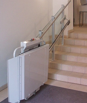 Savaria Delta Inclined Platform Lift attached to an indoor staircase