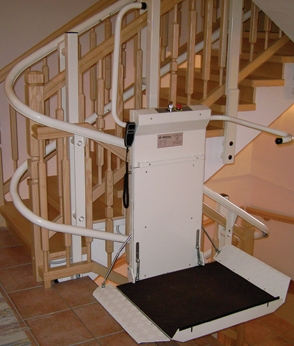 Savaria Omega Inclined Platform Lift attached to U-shaped stairs in a home